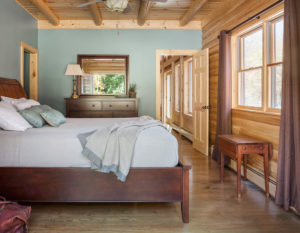Lynn Lassond uses her smart phone to help customers select finishes for their Katahdin Cedar Log Home.