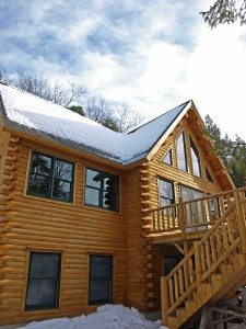 Designing for snow includes determining roof pitch and snow loads for Katahdin Cedar Log Homes