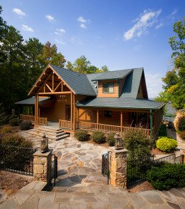 A combination of hardscaping & landscaping complement this Katahdin Cedar Log Home perfectly.