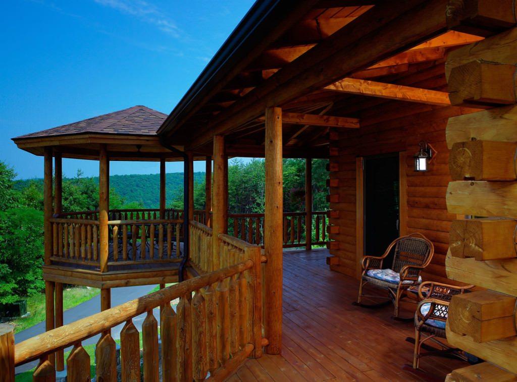 Bonanza 04268 katahdin cedar log homes for Log home decks