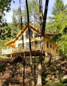 Log off in this Katahdin Cedar Log Home