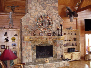 Custom woodworking adds style to this fireplace mantle in a Katahin Cedar Log Home.