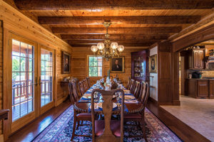 Formal dining in Victorian log home by Katahdin Cedar Log Homes