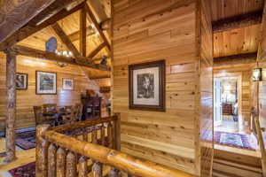 Victorian log home decor with modern elevator in Katahdin Cedar Log Home
