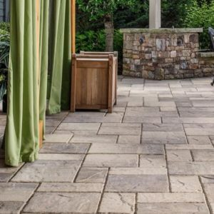 Rustic slab pavers complement traditional Katahdin Cedar Log Homes