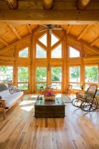 Custom Log Home interior with floor to ceiling windows