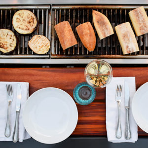 Veggis or meats, social grilling tables offer guests flexibility when entertaining at your Katahdin Cedar Log Home