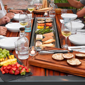 Social grilling tables by iBBQ can enliven your Katahdin Cedar Log Home entertaining.
