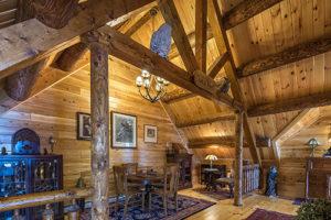 Owls Nest nook has wooden carvings to complement Katahdin Cedar Log Home & Victorian Log HomeDecor