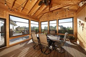 Adjust Scenix retractable screen windows to access breezes in your Katahdin Cedar Log Home