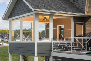 Scenix white retractable screen windows expand the outdoors in Katahdin Cedar Log Homes