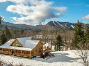 Log off in this Katahdin Cedar Log HOme with all the amenities